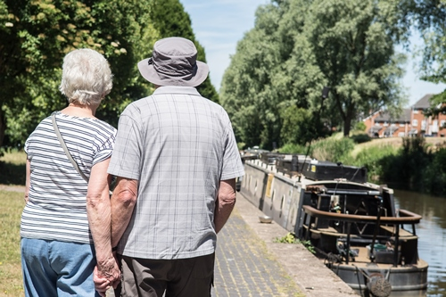 Couple walking along the Trent & Mersey Canal